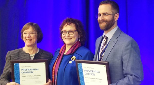 Mary L. Williams MD and Misha Rosenbach MD receive Presidential Citations from AAD President Suzanne Olbricht for their work establishing an Expert Resource Group on Climate Change and Environmental Issues with the American Academy of Dermatology.